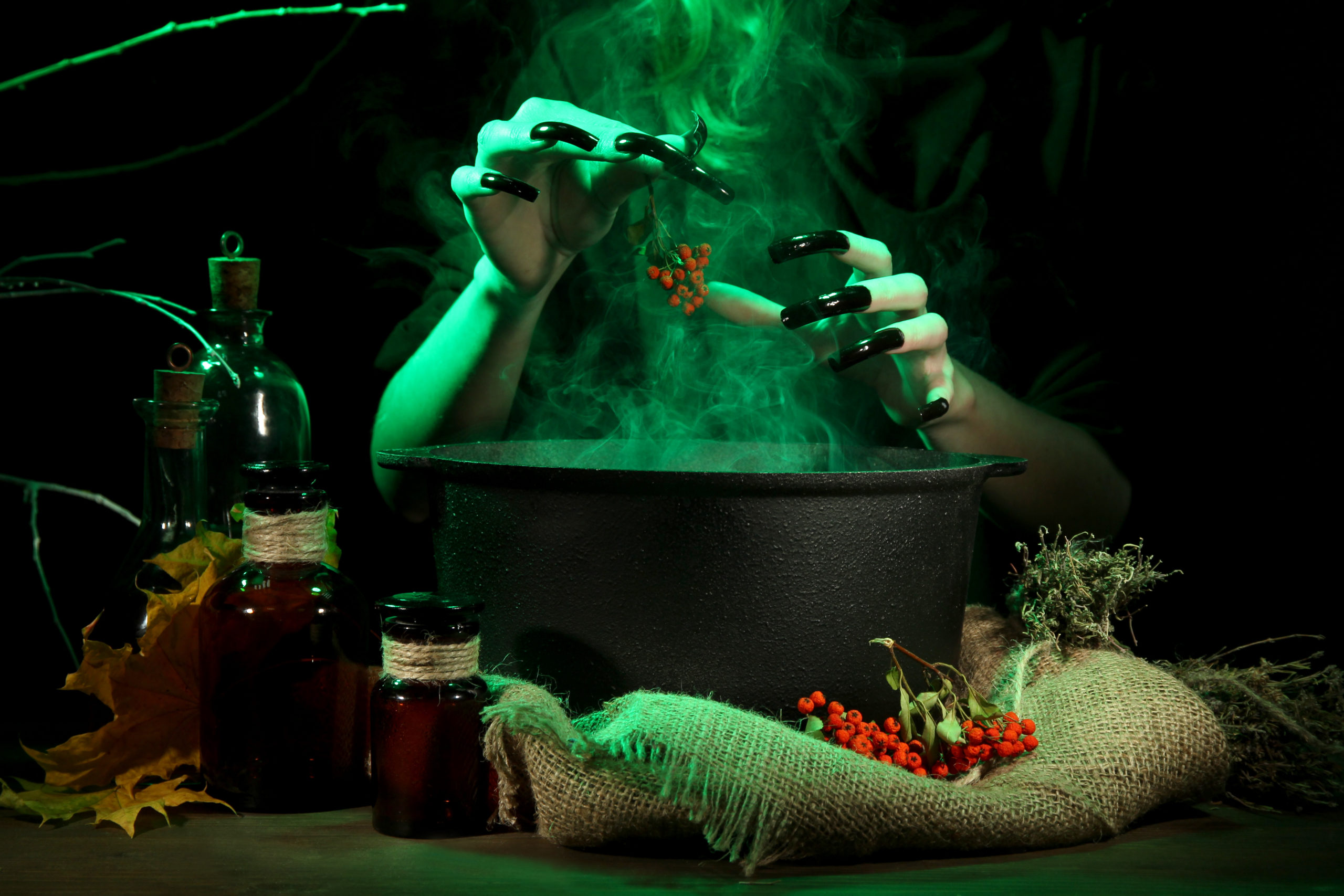 The Witch's Cauldron Escape Room - brewing a potion in a cauldron